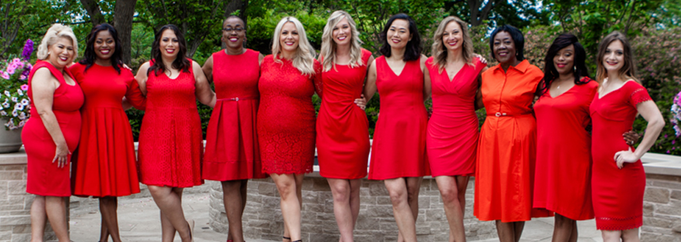 group of women in red dresses